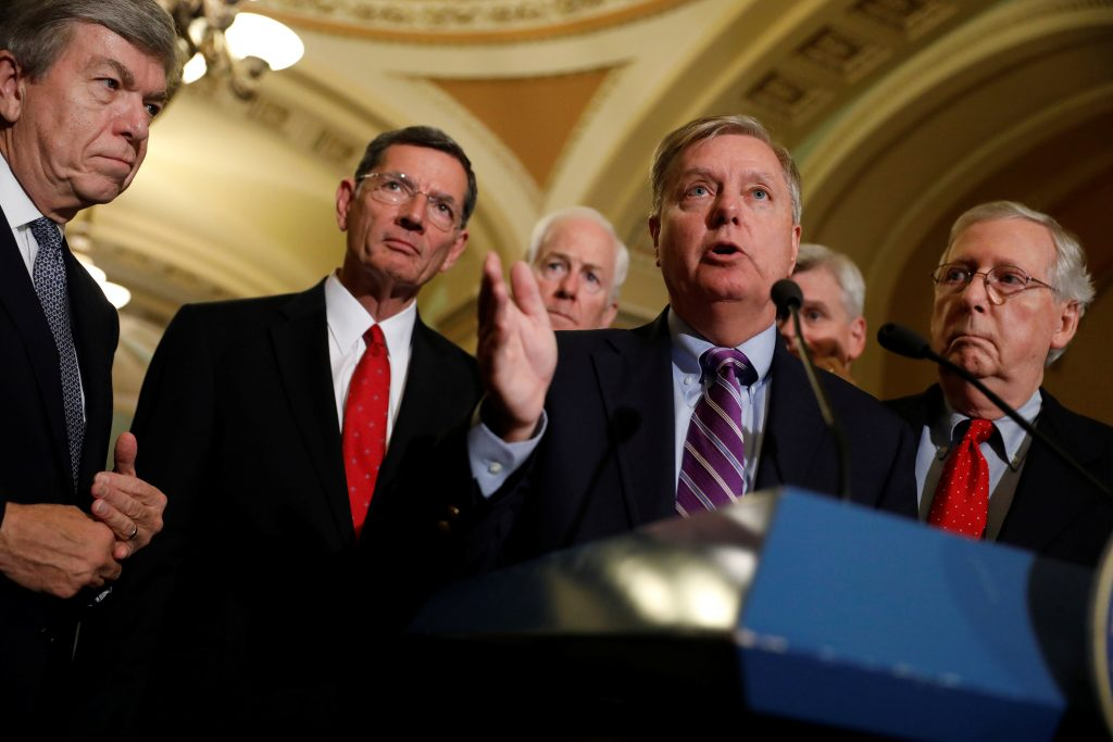 Sen. Lindsey Graham (R-SC), accompanied by Sen. Roy Blunt (R-MO), Sen. John Barrasso (R-WY), Sen. John Cornyn (R-TX) and Senate Majority Leader Mitch McConnell, speaks with reporters following the party luncheons on Capitol Hill in Washington, U.S., September 19, 2017. REUTERS/Aaron P. Bernstein - RC130478C500