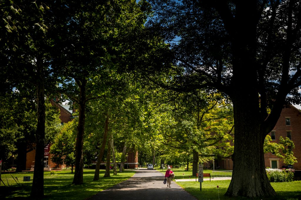 An alumna walks through Antioch College's campus, during the reunion weekend in Yellow Springs, Ohio Saturday, July 15, 2017. Photo: Meg Vogel for The Hechinger Report