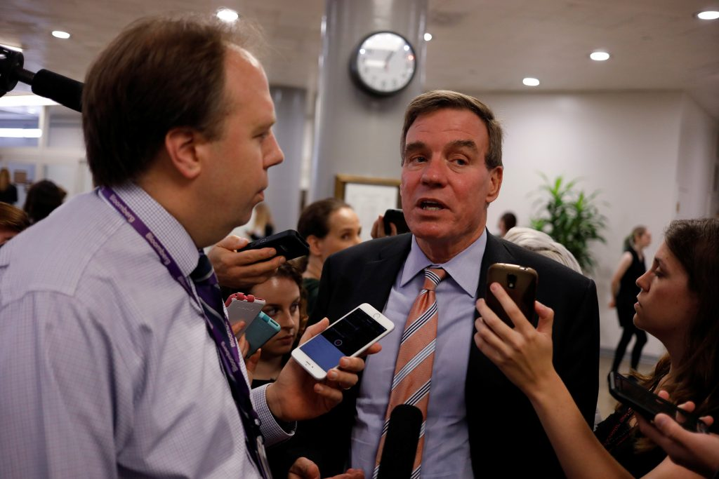 Senator Mark Warner (D-VA) speaks to reporters ahead of the weekly party luncheons on Capitol Hill in Washington, U.S., August 1, 2017. REUTERS/Aaron P. Bernstein - RC1DD9DAE520