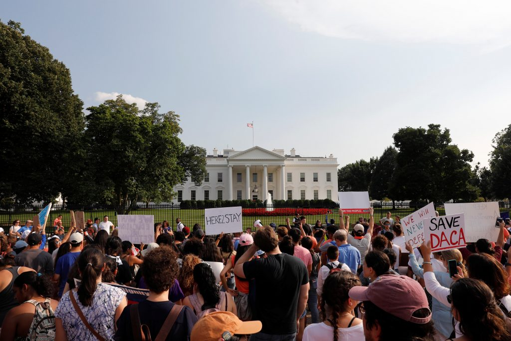 Protestors gather outside the White House to protest President Donald Trump's plan to repeal DACA in Washington, U.S., September 5, 2017. REUTERS/Aaron P. Bernstein - RC14C293E930