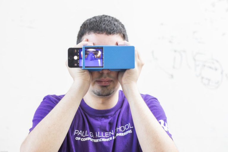 BiliScreen is a new smartphone app that is designed to screen for pancreatic cancer by having users snap a selfie. It's shown here with a 3-D printed box that helps control lighting conditions to detect signs of jaundice in a person's eye. Photo by Dennis Wise/University of Washington