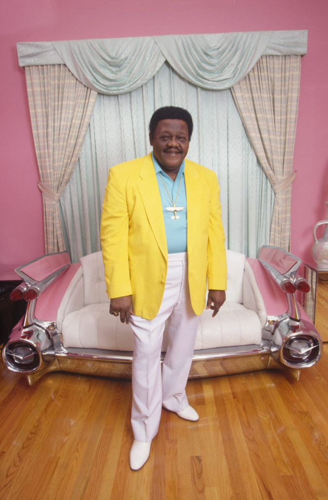 "Antoine ""Fats"" Domino poses in front of his Cadillac sofa at his home in New Orleans' 9th Ward, the neighborhood where he grew up. (Photo by Philip Gould/Corbis via Getty Images)"