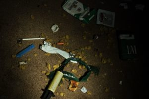 "Drug paraphernalia and other garbage litter a vacant house on April 19, 2017 in Huntington, West Virginia. Huntington, the city in the northwest corner of West Virginia, bordering Kentucky, has been portrayed as the epicenter of the opioid crisis. On August 15, 2016, from 3:00 pm to 9:00 pm, 28 people in the city overdosed on heroin laced with fentanyl, a synthetic opioid far more powerful and dangerous than heroin. The economic incentives are powerful: one kilogram of fentanyl costs $5,000, which can make a million tablets sold at $20 each for a gain of $20 million. ""This epidemic doesn't discriminate,"" Huntington Mayor Steve Williams said. ""Our youngest overdose was 12 years old. The oldest was 77."" / AFP PHOTO / Brendan Smialowski / TO GO WITH AFP STORY by Heather SCOTT, US-health-drugs-WestVirginia (Photo credit should read BRENDAN SMIALOWSKI/AFP/Getty Images)"