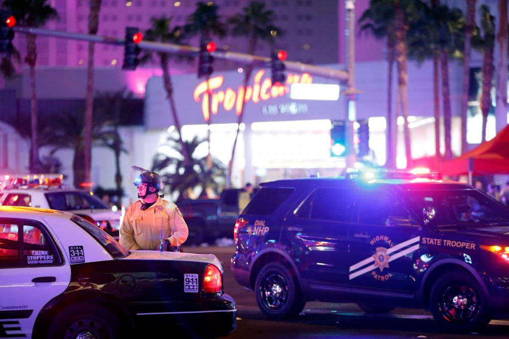 Las Vegas Metro Police officer stands by at a staging area in the intersection of Tropicana Avenue and Las Vegas Boulevard South after a mass shooting at a music festival on the Las Vegas Strip in Las Vegas, Nevada, U.S. early October 2, 2017. Photo by Las Vegas Sun/Steve Marcus/REUTERS