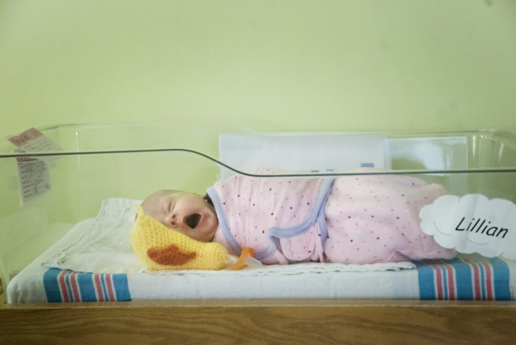 A baby rests between doses of medication in the neonatal unit. Photo by Abbey Oldham.