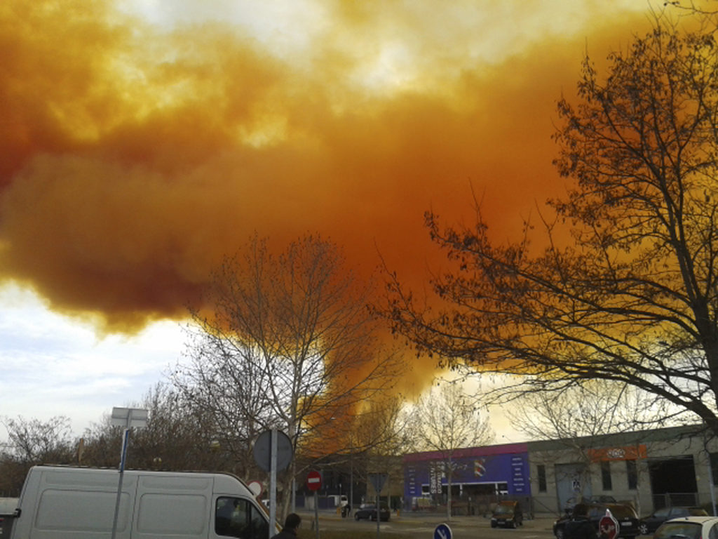 An orange toxic cloud is seen over the town of Igualada, near Barcelona following an explosion in a chemical plant, February 12, 2015. Three people were injured in the explosion at the chemical plant in northern Spain on Thursday and authorities advised residents of several small towns near Barcelona to stay indoors as the large toxic cloud spread over the area. Catalan authorities told people to shut their windows and stay inside as a precaution, and cut off some roads in the area as well as a train line. REUTERS/Paula Arias