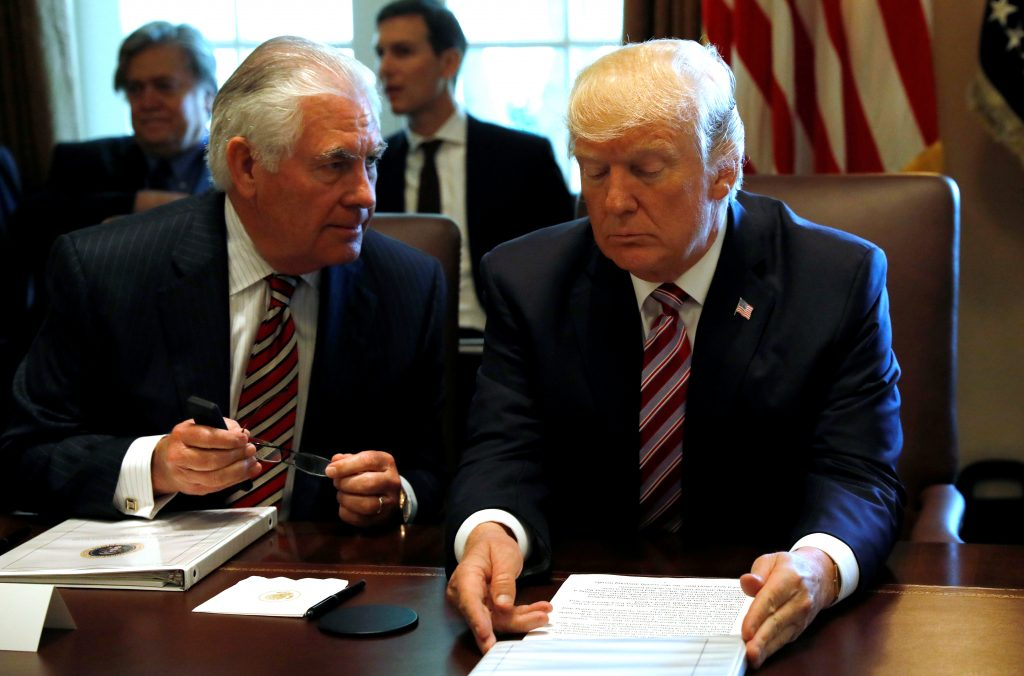 President Donald Trump talks with Secretary of State Rex Tillerson during a meeting with members of his Cabinet at the White House in Washington, D.C. Photo by Kevin Lamarque/Reuters