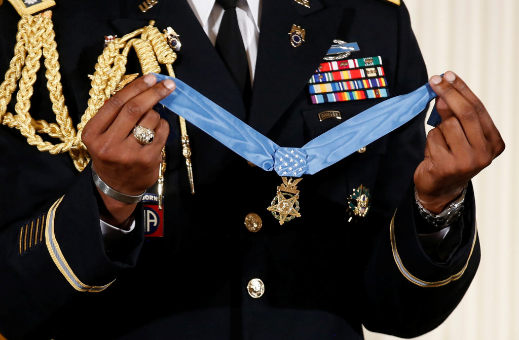 A military aide holds the Medal of Honor before U.S. President Donald Trump awarded it to James McCloughan, who served in the U.S. Army during the Vietnam War, during a ceremony at the White House in Washington, U.S. July 31, 2017. REUTERS/Joshua Roberts - RC1F7845DAD0