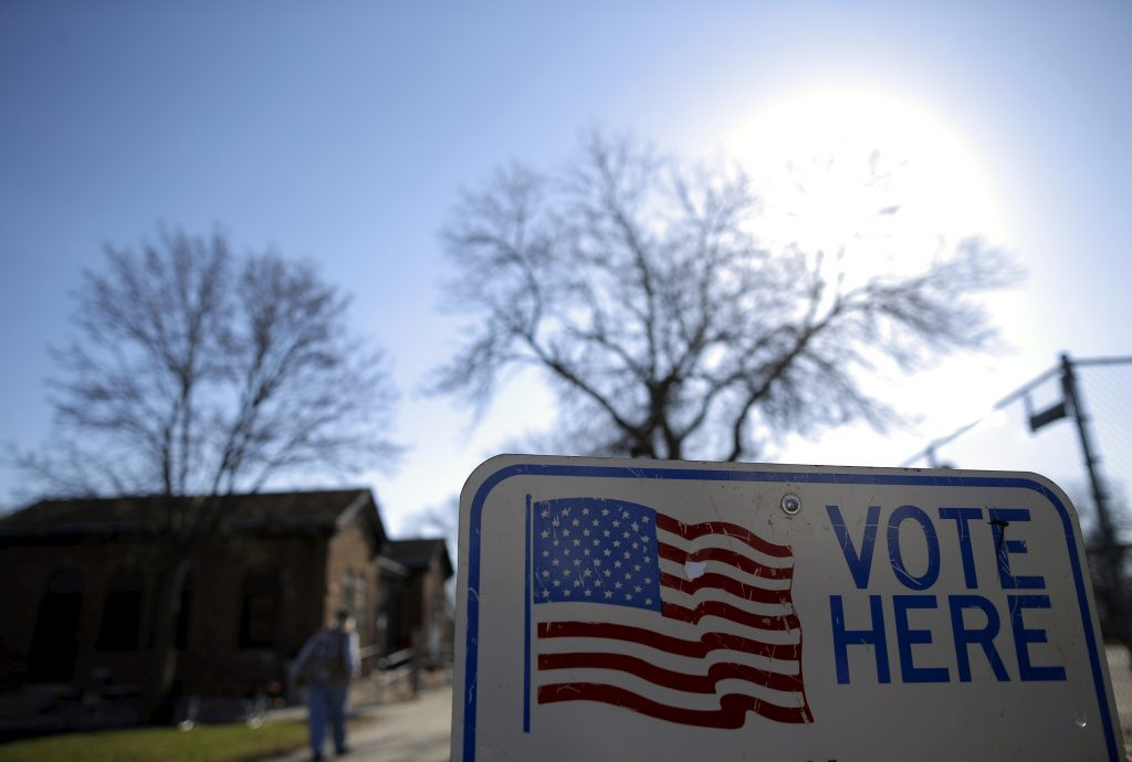 FILE PHOTO: A voter arrives to cast their ballot in the Wisconsin presidential primary election at a voting station in Milwaukee, Wisconsin, U.S. on April 5, 2016. REUTERS/Jim Young/File Photo - RC1B4F23EF90