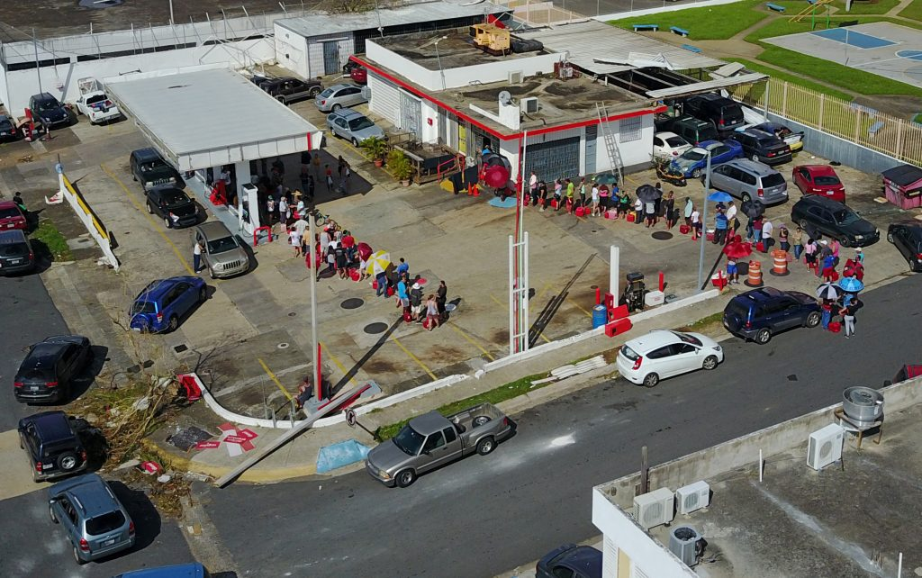 An aerial photo shows people lining up at a gas station follwing damages caused by Hurricane Maria in San Juan Puerto Rico