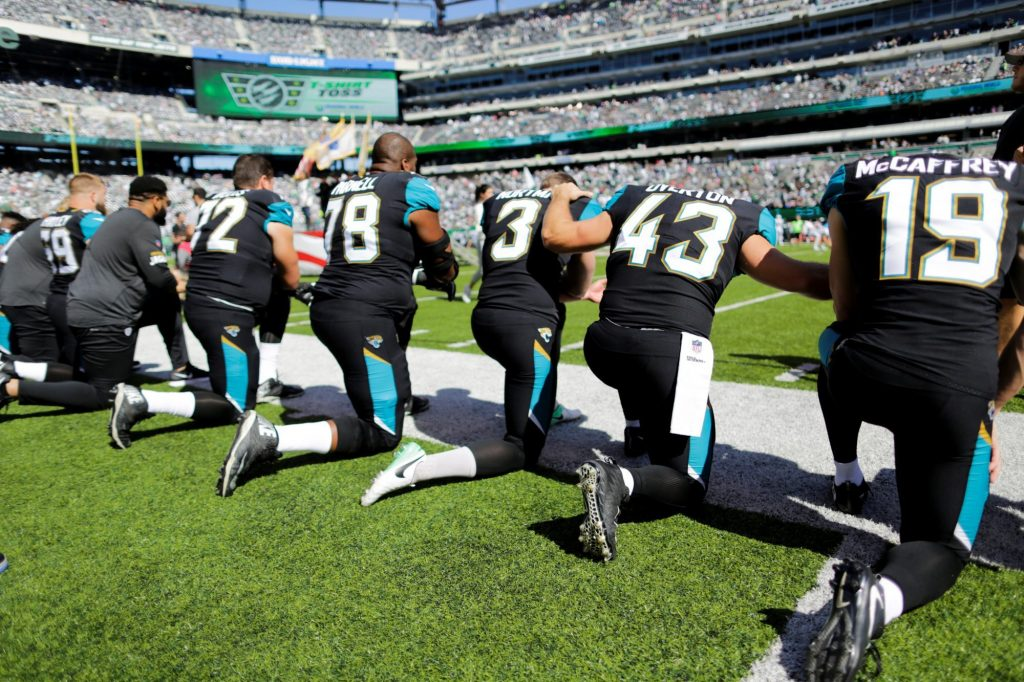 Jacksonville Jaguars NFL players kneel before the national anthem before their game against the New York Jets on Oct. 1, 2017. Photo by REUTERS/Eduardo Munoz
