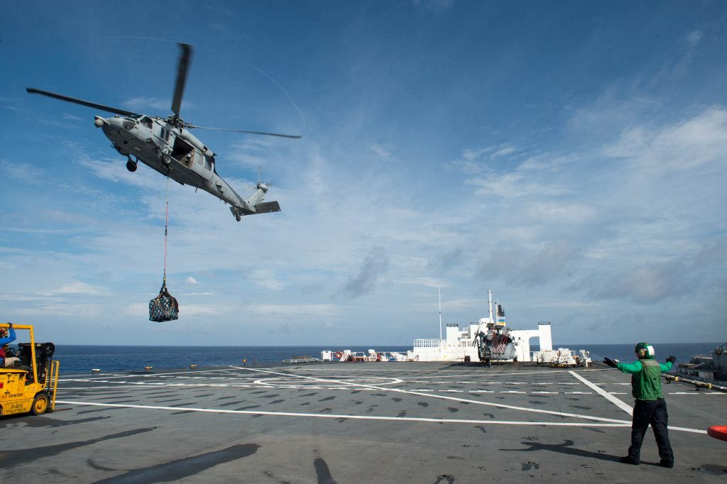An MH-60S Sea Hawk helicopter delivers cargo to the hospital ship USNS Comfort as the ship is underway in support of humanitarian relief operations to help those affected by Hurricane Maria in Puerto Rico. Photo courtesy Danny Ray Nunez Jr./U.S. Navy/Handout via Reuters