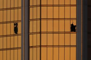 Morning light reflects off the Mandalay Bay hotel and the broken windows where shooter Stephen Paddock conducted his shooting spree from the 32nd floor in Las Vegas, Nevada, in October 2017. Photo by Mike Blake/Reuters