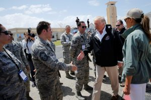 President Donald Trump greets troops as he arrives aboard Air Force One, to survey hurricane damage, at Muniz Air National Guard Base in Carolina, Puerto Rico. Photo by Jonathan Ernst/Reuters