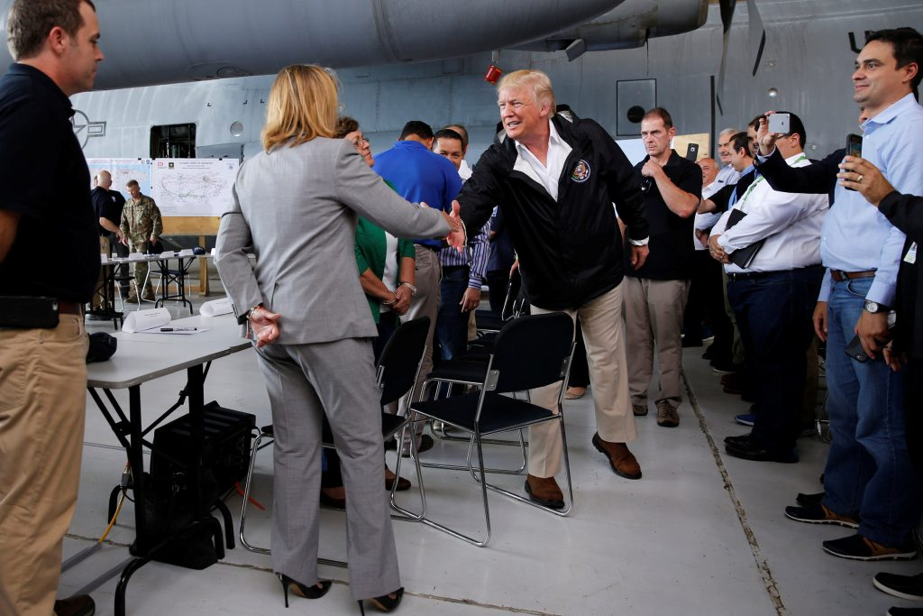U.S. President Donald Trump shakes hands with San Juan Mayor Carmen Yulin Cruz before a briefing to survey hurricane damage, at Muniz Air National Guard Base in Carolina, Puerto Rico, U.S. October 3, 2017. REUTERS/Jonathan Ernst - RC19F8866650