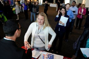 A job seeker talks to a recruiter from UC Health at the Colorado Hospital Association job fair in Denver, Colorado, U.S., October 4, 2017. REUTERS/Rick Wilking - RC1649005850