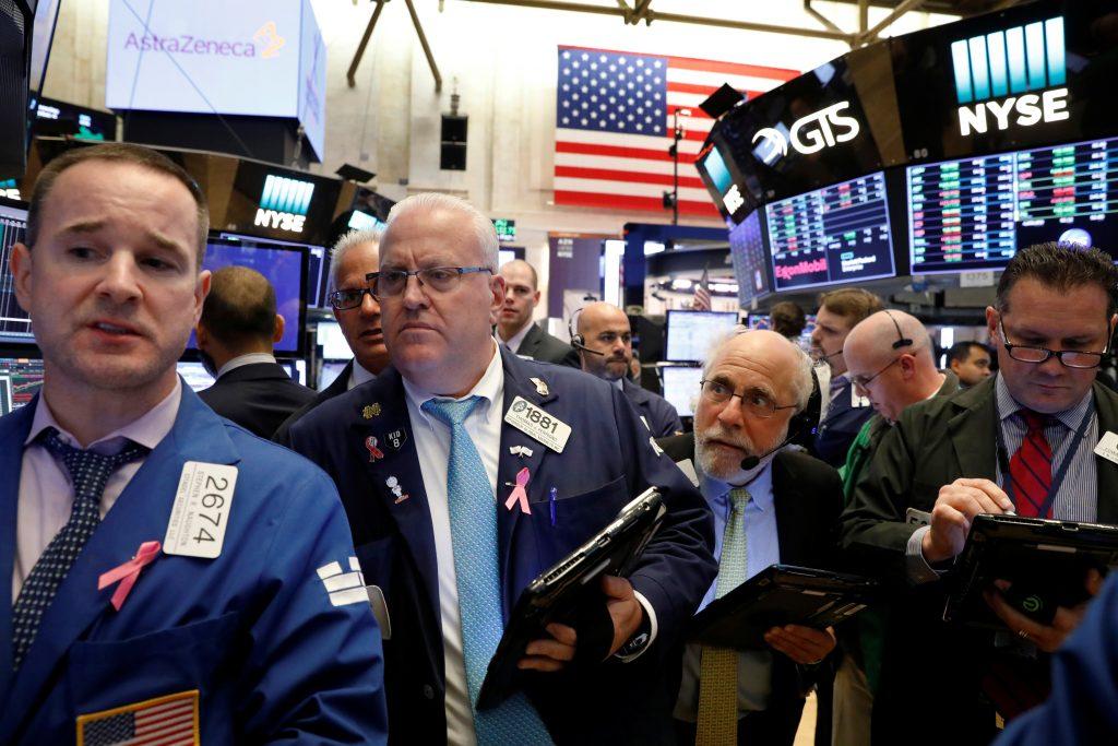 Traders work on the floor of the New York Stock Exchange (NYSE) in New York, U.S., October 4, 2017. REUTERS/Brendan McDermid - RC18123EF150