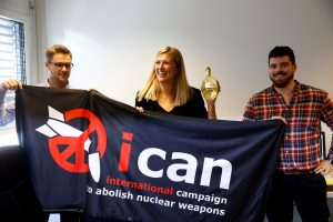 Beatrice Fihn, Executive Director of the International Campaign to Abolish Nuclear Weapons (ICAN) receives a bottle of champagne from her husband Will Fihm Ramsay (R) next to Daniel Hogsta, coordinator, while they celebrate after ICAN won the Nobel Peace Prize 2017, in Geneva, Switzerland. Photo by Denis Balibouse/Reuters