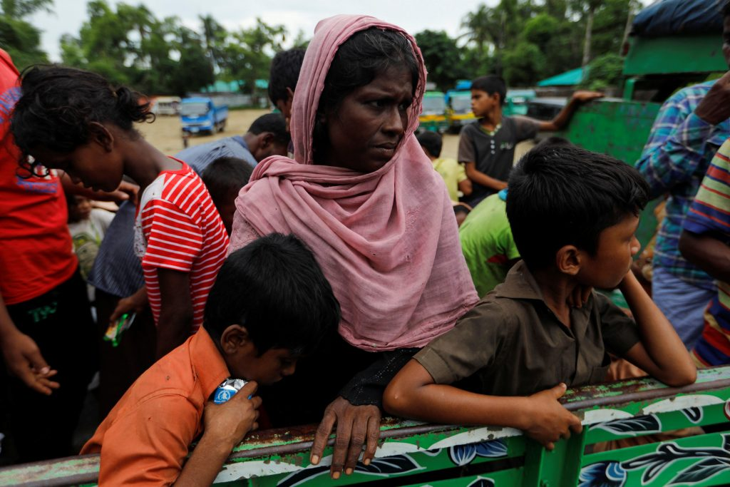 Rohingya refugees ride on the back of the truck to a camp near Teknaf , Bangladesh, on Oct. 12. Photo by Jorge Silva/Reuters