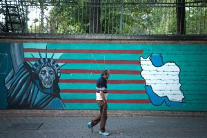 Man walks past anti-U.S. mural in Tehran