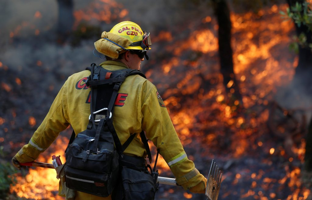 Firefighters work to defend homes from an approaching wildfire in Sonoma, California. Photo by Jim Urquhart/Reuters