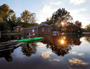 A resident paddles his kayak out of his neighborhood after checking the condition of his house as river levels rise into town in the aftermath of Hurricane Matthew, in Greenville, North Carolina