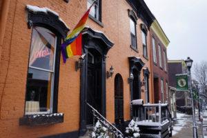 A rainbow flag hangs waves outside Edna's salon in Wheeling, West Virginia