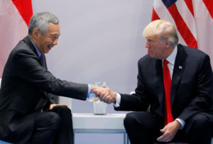 Singapore's Prime Minister Lee Hsien Loong shakes hands with U.S. President Donald Trump during the bilateral meeting st the G20 leaders summit in Hamburg, Germany July 8, 2017. REUTERS/Carlos Barria - RC13A8E72470