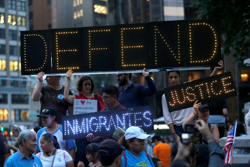 People march and chant slogans against U.S. President Donald Trump's proposed end of the DACA program that protects immigrant children from deportation at a protest in New York City, U.S., August 30, 2017. REUTERS/Joe Penney