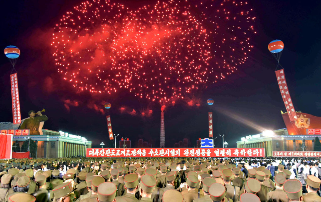 Pyongyang city civilians celebrate the successful completion of the hydrostatic test for the intercontinental ballistic rocket installation in this undated photo released by North Korea's Korean Central News Agency (KCNA) in Pyongyang September 6, 2017. KCNA via REUTERS ATTENTION EDITORS - THIS PICTURE WAS PROVIDED BY A THIRD PARTY. REUTERS IS UNABLE TO INDEPENDENTLY VERIFY THE AUTHENTICITY, CONTENT, LOCATION OR DATE OF THIS IMAGE. NOT FOR SALE FOR MARKETING OR ADVERTISING CAMPAIGNS. NO THIRD PARTY SALES. NOT FOR USE BY REUTERS THIRD PARTY DISTRIBUTORS. SOUTH KOREA OUT. NO COMMERCIAL OR EDITORIAL SALES IN SOUTH KOREA. THIS PICTURE IS DISTRIBUTED EXACTLY AS RECEIVED BY REUTERS, AS A SERVICE TO CLIENTS. - RC1C2D602FD0