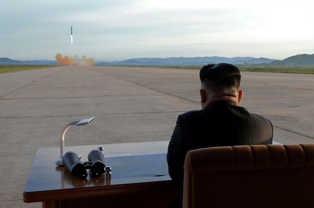 North Korean leader Kim Jong Un watches the launch of a Hwasong-12 missile in this undated photo released by North Korea's Korean Central News Agency (KCNA) on Sept. 16. Photo by KCNA via Reuters