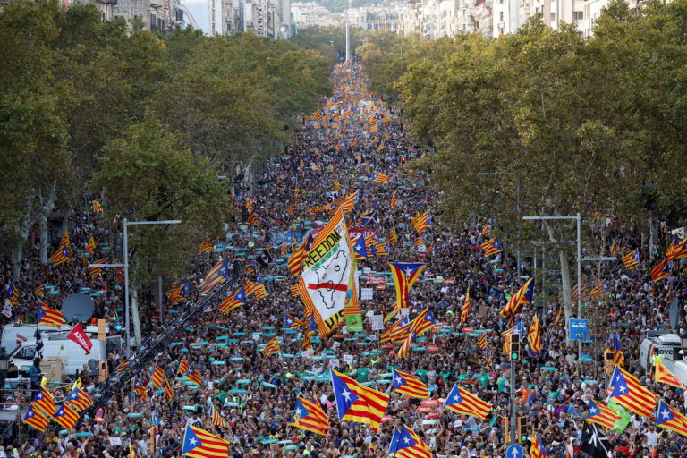 People wave Catalan separatist flags during a demonstration organised by Catalan pro-independence movements ANC (Catalan National Assembly) and Omnium Cutural, following the imprisonment of their two leaders Jordi Sanchez and Jordi Cuixart, in Barcelona