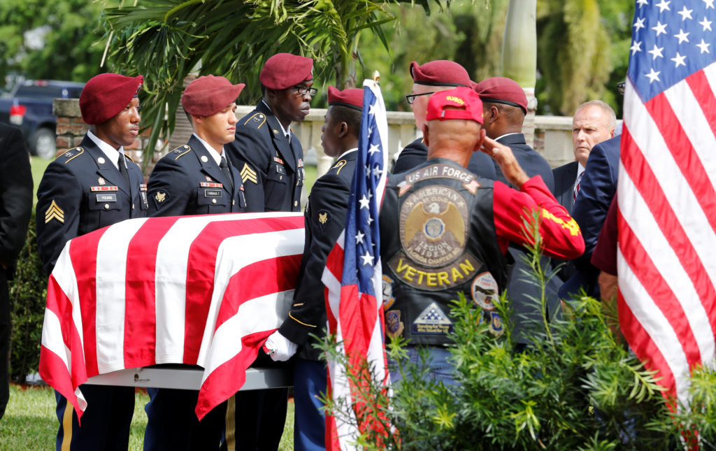 An honor guard carries the coffin of U.S. Army Sergeant La David Johnson, who was among four special forces soldiers killed in Niger, at a graveside service in Hollywood, Florida, October 21, 2017. REUTERS/Joe Skipper - RC119B87D780