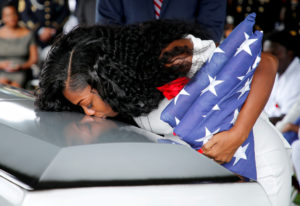 Myeshia Johnson, wife of U.S. Army Sergeant La David Johnson, who was among four special forces soldiers killed in Niger, kisses his coffin at a graveside service in Hollywood, Florida, October 21, 2017. REUTERS/Joe Skipper