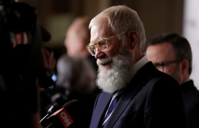 Comedian David Letterman speaks to the media as he arrives for a gala where he is receiving the Mark Twain Prize for American Humor at Kennedy Center in Washington, U.S., October 22, 2017. REUTERS/Joshua Roberts - RC184E10D840