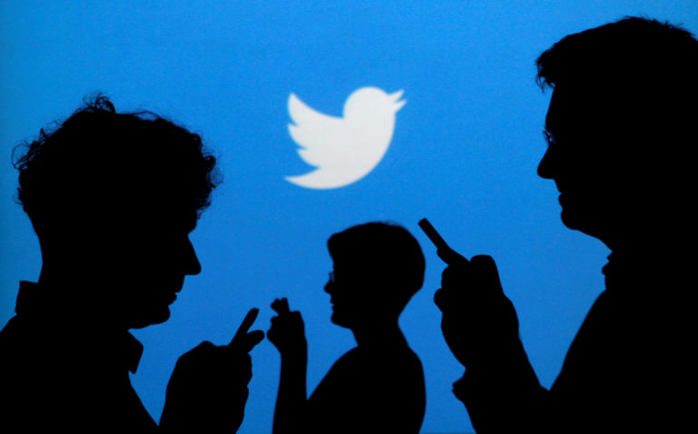 FILE PHOTO - People holding mobile phones are silhouetted against a backdrop projected with the Twitter logo in this illustration picture taken in Warsaw September 27, 2013. REUTERS/Kacper Pempel/File Photo GLOBAL BUSINESS WEEK AHEAD SEARCH GLOBAL BUSINESS OCT 23 FOR ALL IMAGES - RC1166FF1530