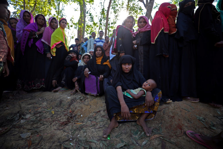 Rohingya line up to receive humanitarian aid in Kutupalong refugee camp near Cox's Bazar, Bangladesh, on Oct. 23. Photo by Hannah McKay/Reuters