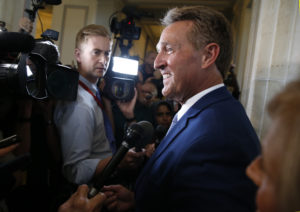 Sen. Jeff Flake (R-Ariz.) faces reporters after announcing he will not run for reelection on Capitol Hill in Washington, D.C. Photo by Joshua Roberts/Reuters