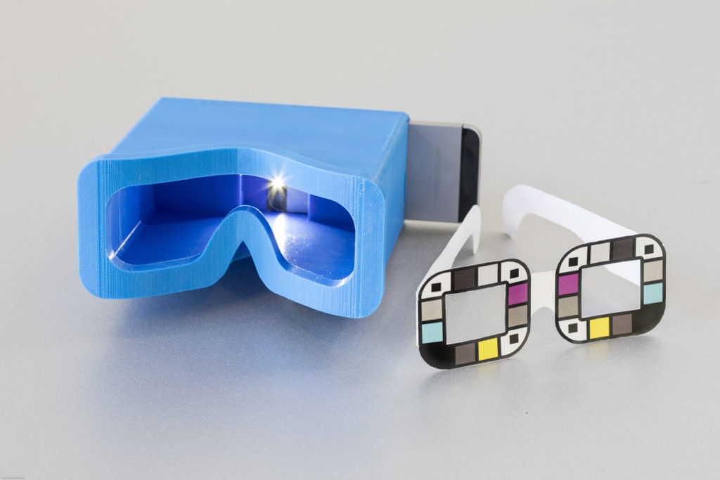 The UW team tested two different accessories for BiliScreen: a 3-D printed box to control lighting conditions and glasses that help the app calibrate colors. The goal is to remove the need for additional accessories, potentially by mining data from facial pictures. Photo by Dennis Wise/University of Washington