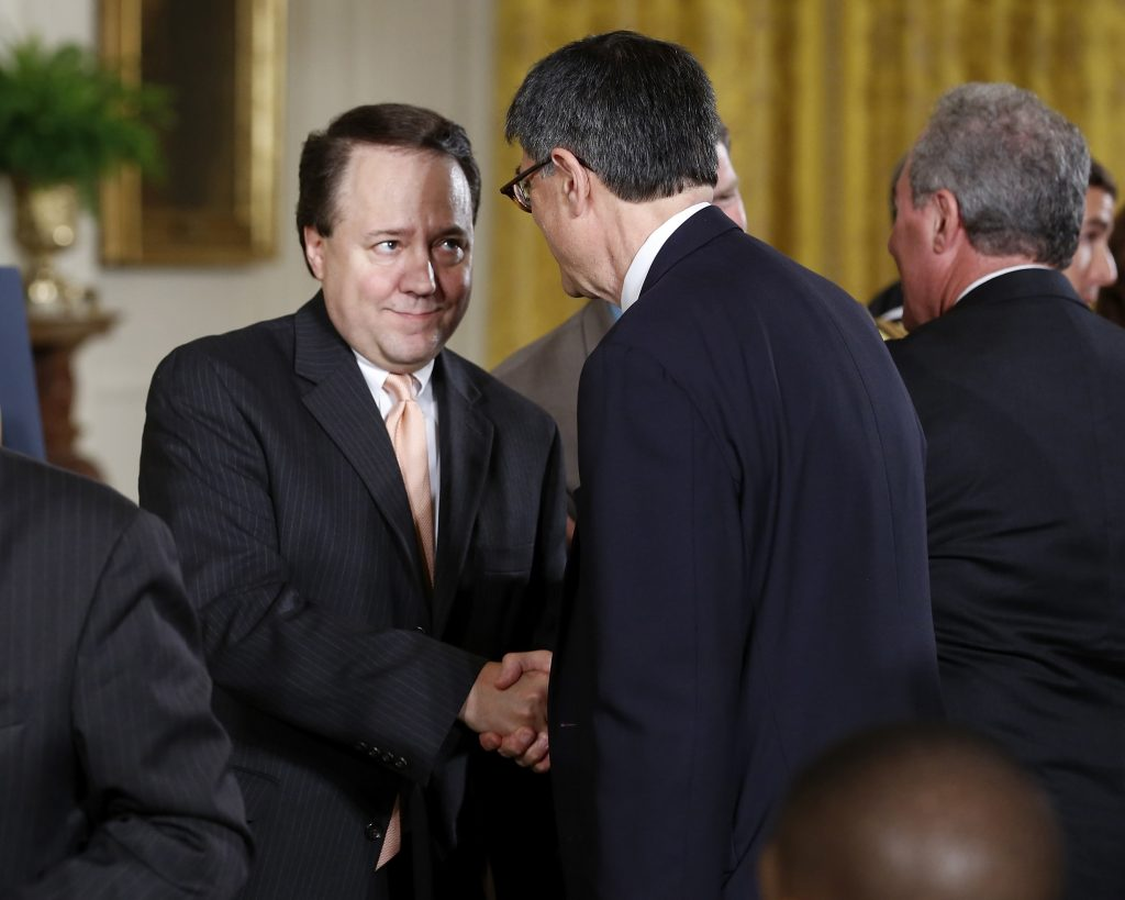 "U.S. Treasury Secretary Jack Lew (2nd R, back to camera) shakes hands with U.S. House members who supported trade legislation, including Representative Pat Tiberi (R-OH) (C) before U.S. President Barack Obama arrives to sign House Resolution 2146, the ""Defending Public Safety Employees' Retirement Act and Trade Preference Extension Act of 2015,"" during a ceremony in the East Room of the White House in Washington June 29, 2015. REUTERS/Jonathan Ernst"