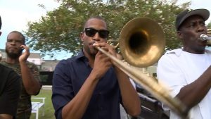 Trombone Shorty joins a 'second line' in New Orleans. Credit: Jason Lelchuk