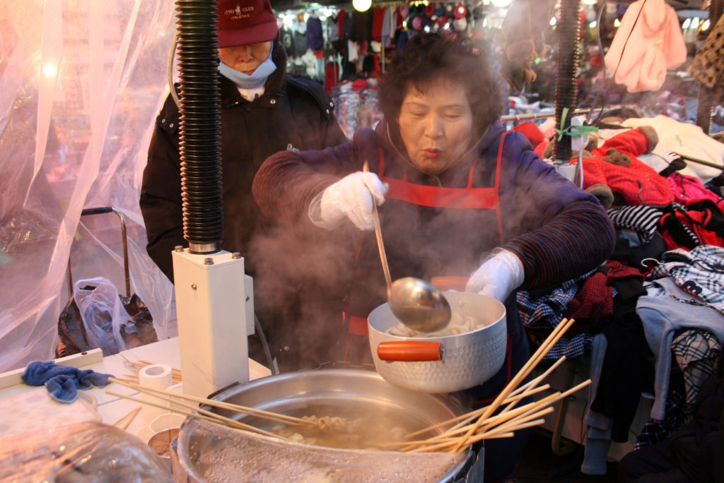 A woman serves soup at a street market in Seoul, South Korea. Photo by Larisa Epatko/PBS NewsHour