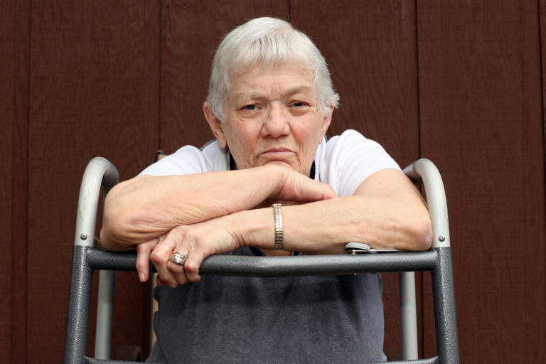 Elderly woman with a distraught look on her face.