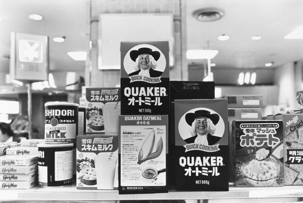 Food products, including Quaker Oats with labels in English and Japanese, on display in a Tokyo department store, February 1988. (Photo by Barbara Alper/Getty Images)