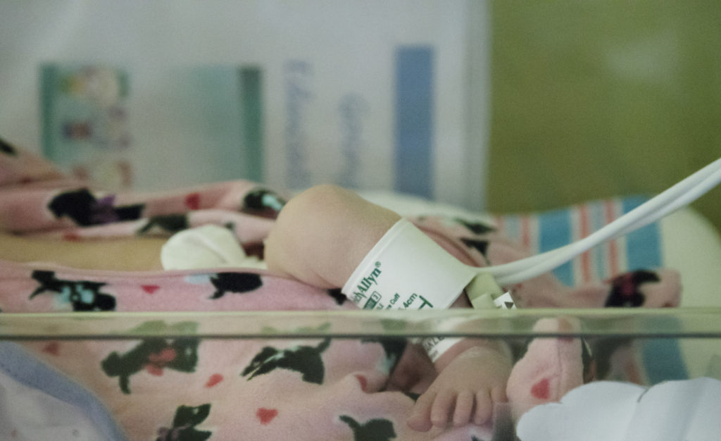 A baby rests before receiving treatment for opioid withdrawal at a hospital unit devoted to babies diagnosed with neonatal abstinence syndrome in Huntington, West Virginia. Photo by Abbey Oldham/PBS NewsHour