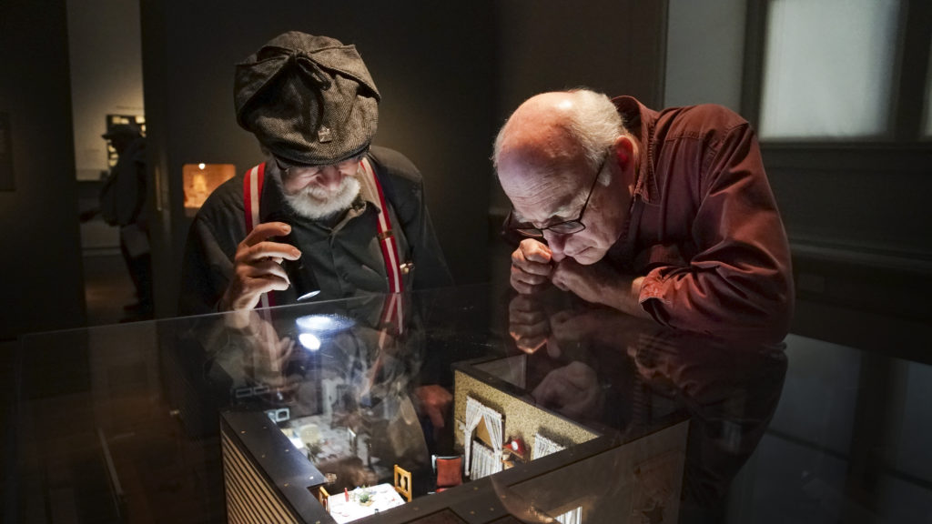 Arnold Simon or Pikesville, MD (left) and Jon Levy of Bethesda, MD peek into one of the nutshells at the Renwick Gallery on Wednesday, November 15, 2017. Photo by Abbey Oldham
