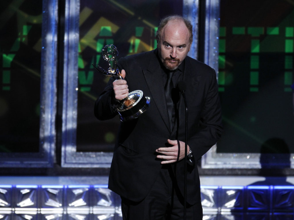 """Louis C.K. accepts the award for outstanding writing for a variety special for """"Louis C.K. Live at the beacon Theatre"""" at the 64th Primetime Emmy Awards in Los Angeles, September 23, 2012. REUTERS/Lucy Nicholson"""