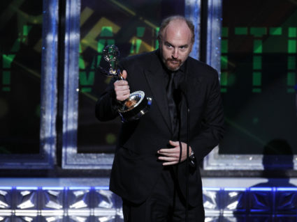 "Louis C.K. accepts the award for outstanding writing for a variety special for ""Louis C.K. Live at the beacon Theatre"" at the 64th Primetime Emmy Awards in Los Angeles, September 23, 2012. REUTERS/Lucy Nicholson"