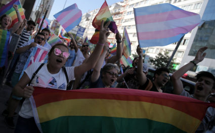 LGBT rights activists shout slogans as they try to gather for a pride parade in Istanbul
