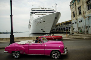 Vintage cars drive by the passengers cruise ship MSC Opera in Havana, Cuba, September 30, 2017. Photo by Alexandre Meneghini/Reuters